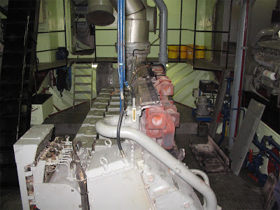 standing in front of main engine, looking astern - on the left, the entrance to the workshop