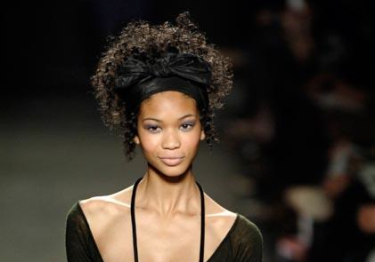 black model Chanel Iman wearing a natural curly black hair style