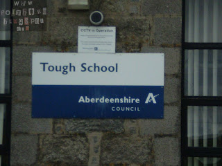 Photo of Tough School sign