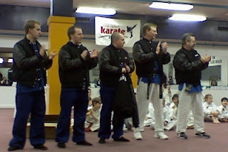 Master Terry Brennan, Master Ian Hafner, Master Jason Hafner, Greg Peters, and Peter Gluck