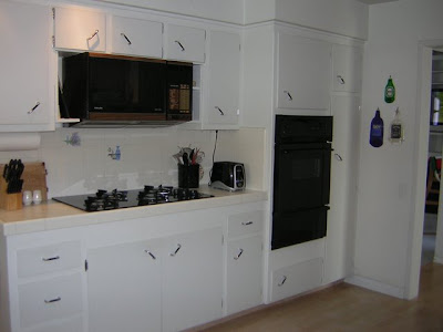 Before: Three entries into the kitchen makes for an awkward layout