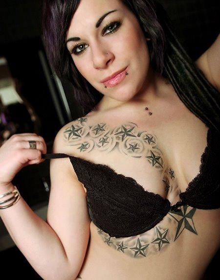 Breast  star tattoo