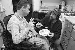 An emergency attendant helps a man to eat and wheelchair repair shop. Courtesy EDI