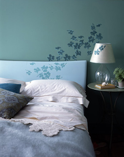 flowers flow from the bed to the wall to the lamp