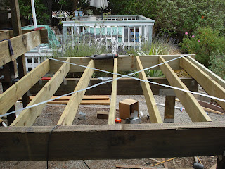 hot tub deck framing the tub pre staining 16 guage x bracing joists about 14 on center