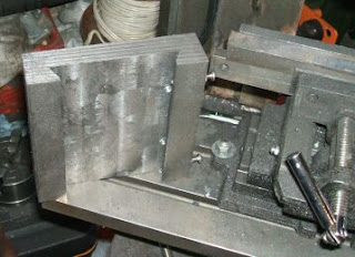 """The carriage I made from a 1 1/2"""" x 6"""" x 6"""" block of steel, and cut a dovetailed grove in the bottom (left). The problem I had at this point was ..."""