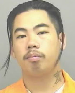 BADFELLAS: Chuckie Vang, the pint-sized thug they say is a