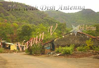 Village hut with Dish Antenna in Mulshi, India