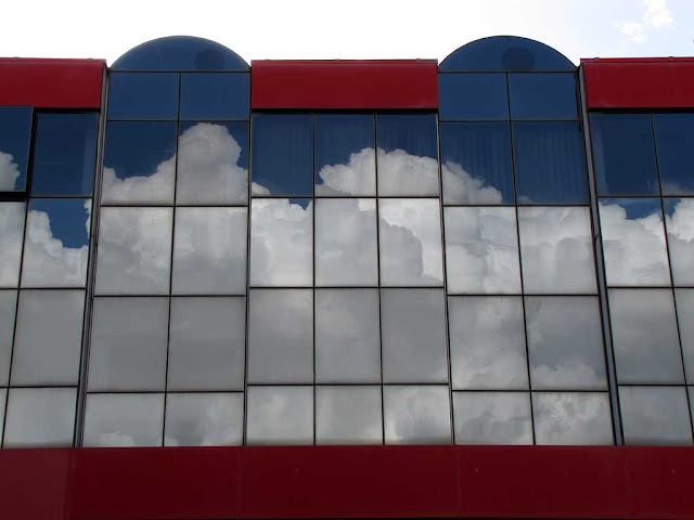 Clouds reflected in a window, Livorno