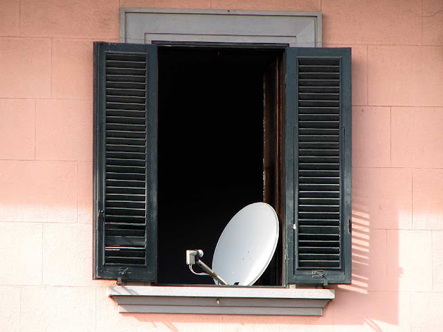 Satellite dish mounted inside a window, Livorno