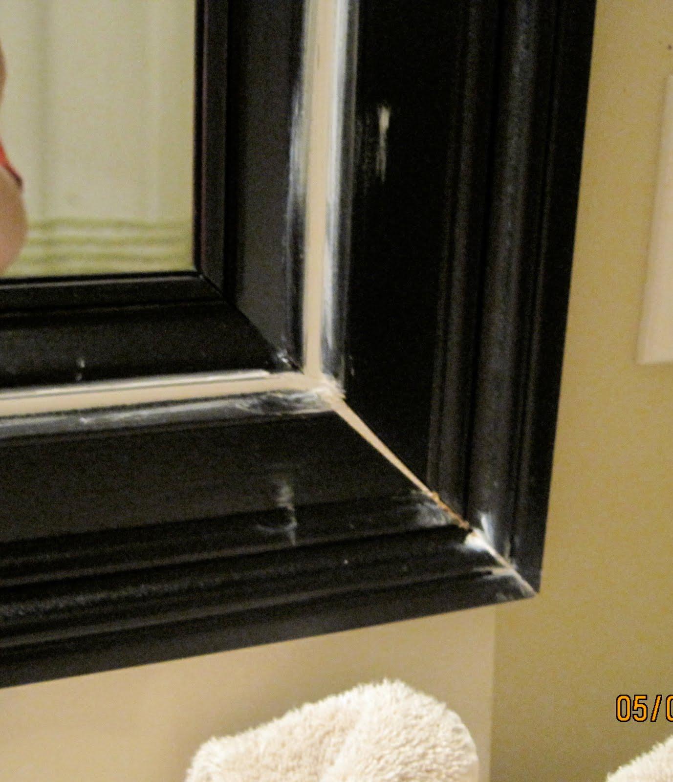 Bathroom mirror frame tutorial remodelaholic - How to frame an existing bathroom mirror ...