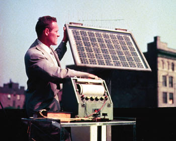 Bell Labs engineer testing solar battery
