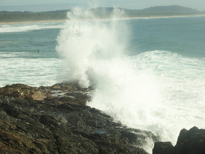 wave breaking with tremendous power at moonee beach, coffs harbour, nsw, australia