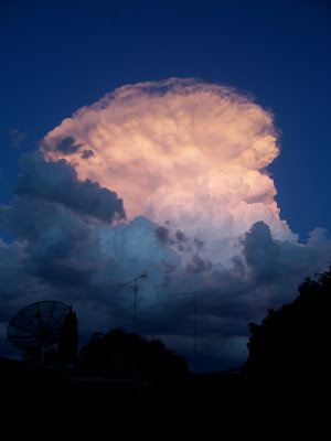 cumulonimbus thunder storm clouds at sunset