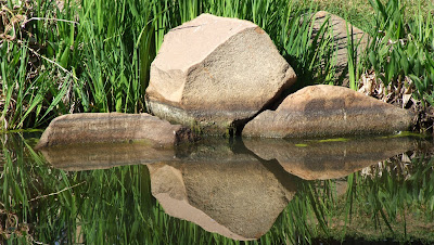 stones / rocks with a reflection in the water - restful waters with reflection