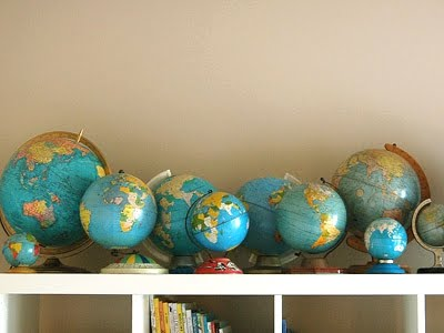 vintage globe collection on shelf