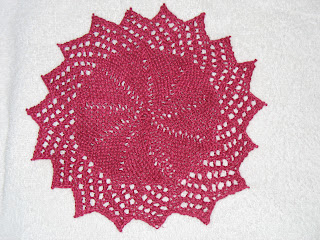 this knitted lacy round dishcloth is a free pattern from knitting