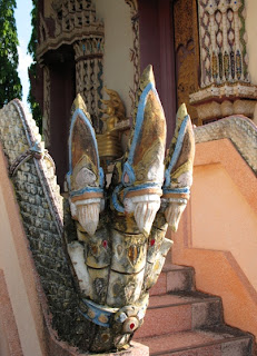 3 headed snake (Naga or Naka) at the entrance to the temple