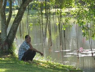 Man on the phone next to lake in Phuket Town