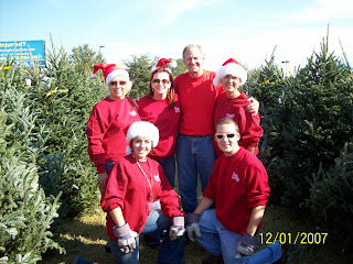 The Miller Team posing for the camera at The Boys and Girls Club Christmas Tree Sale in Panama City