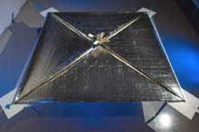 Photon flight: NASA's NanoSail-D is a small satellite that can move through space using a solar sail propelled by pressure from photons. The sail, fully expanded to 10 square meters in this image, is a very thin sheet of plastic coated with aluminum.