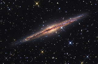 The spiral galaxy NGC891 seen edge on reveals a dark lane of dust