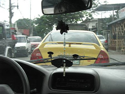 Manila traffic as seen through a taxi's windshield