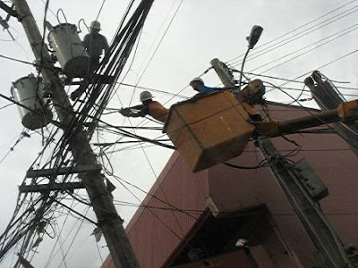 Meralco repair crew on a utility pole