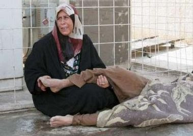 Iraqi woman mourning her killed son