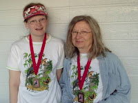 Sweet Pea and Eagle Momma model their finisher's shirts and medals