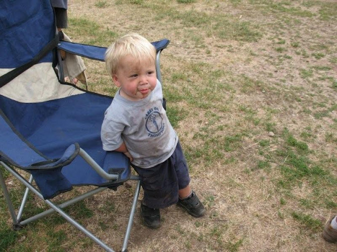 Kyler at my family reunion... got a little dirty in the fire pit
