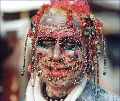 tattoos and piercings as long as they don't disfigure themselves like this: