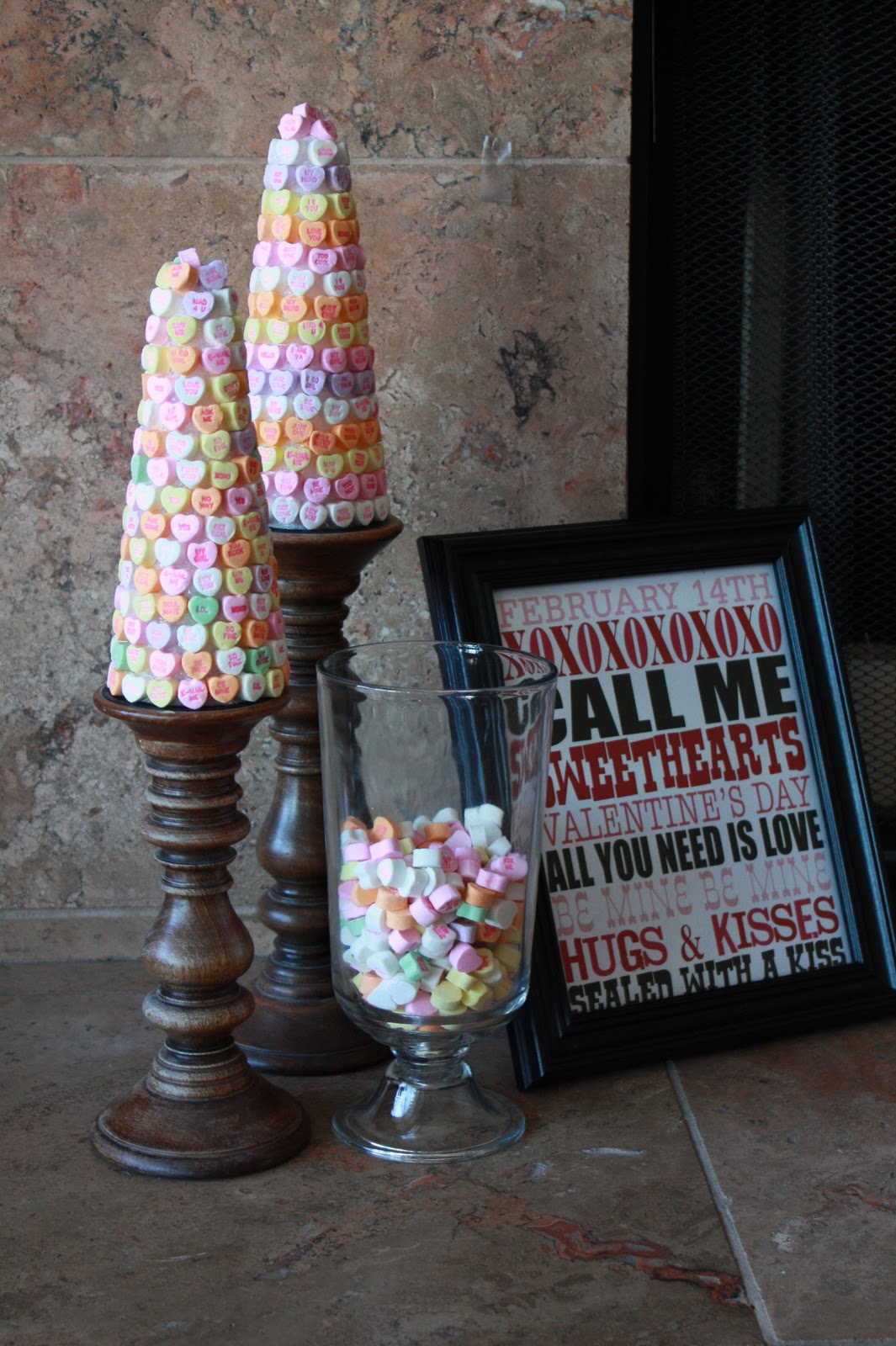 Love these candy topiaries using conversation heart for valentine's. It's perfect for Valentine's candy decor!