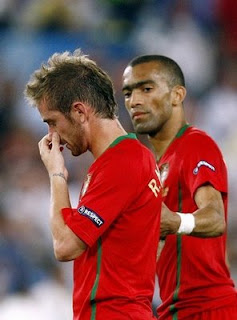 Raul Meireles and Jose Bosingwa look dejected at the end of the Euro 2008 Championships quarter-final football match Portugal vs. Germany