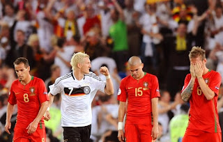 Bastian Schweinsteiger celebrates surrounded by Portuguese midfielder Petit (L), defender Pepe (2ndR) and midfielder Raul Meireles after German forward Miroslav Klose scored his team's third goal during the Euro 2008 Championships quarter-final football match Portugal vs. Germany
