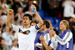 German midfielder Michael Ballack (L) celebrates after winning the Euro 2008 Championships quarter-final football match Portugal vs. Germany