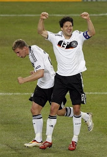 Germany's Michael Ballack, right, celebrates with teammate Lukas Podolski after scoring his side's third goal during the quarterfinal match between Portugal and Germany