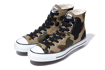 b6330f7054d3 ... A Bathing Ape looks to drop a new version of its Apesta sneaker focused  around the trademark camouflage print. The shoes feature a canvas upper  with ...