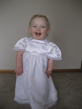 Alivia in her blessing dress