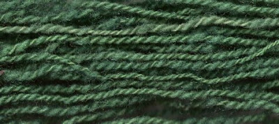 Comparing the new green yarn with one strand of the original green.