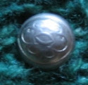 5/8 inch embossed pewter button.