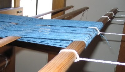 The end of my 1st warp looped around the back apron rod.