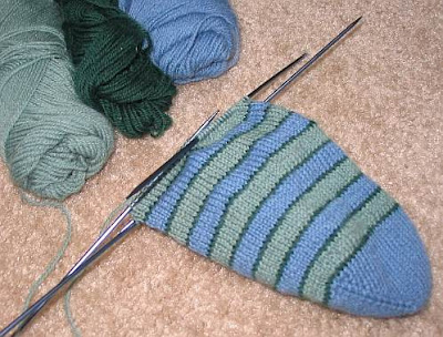First of a pair of striped toe up socks.