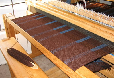 Front of loom with cloth protector in place.