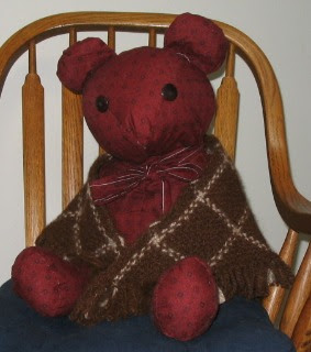 One of my daughter's teddy bears models the shawl.