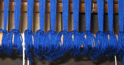 Lovely royal blue Red Heart tied onto the front apron rod.