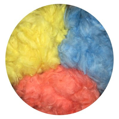Cotton lint dyed, dried, & fluffed for a photo.