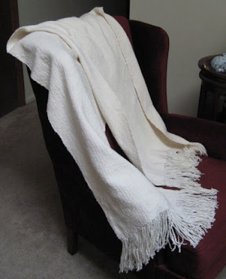 Leigh's handwoven slubby, plain weave shawl.
