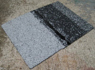 A scrap of asphalt shingle