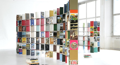 Bookshelves made from books :  interior design environmentally-conscious eco-friendly room divider